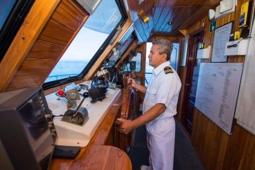 Captain in the Bridge of the San Jose Yacht